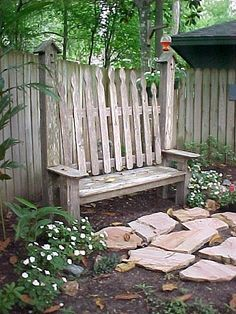cute fence bench! Love the birdhouse posts!