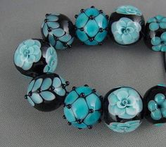 Hey! Found my work on another board! Thanks for pinning me! - Elizabeth Johnston Black and blue bead set
