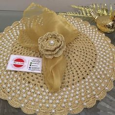 Boa noite!✨✨ . Muito brilho nesses Sousplatscroche com pérolas . . A sua mesa merece . . . Um luxo na sua mesa  Adquira os seus!!❤️ . . . ❌Sousplatscroche com pérolas ➡️50 reais a unidade ❌porta guardanapo de flor em crochê ➡️10 reais a unidade ❌guardanapo de organza 6 reais a unidade Gostou? Curta, siga, e compartilhe!!! . #boatarde #arteemlinha #meseirasdobrasil #sousplat #sousplatscroche ##mesalinda #casanocapricho #tableware #tabletips #maecasei #mesahits ...