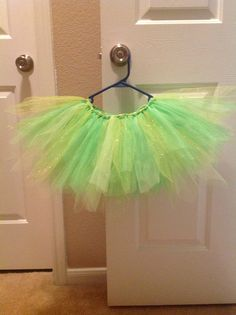 "Diy tinkerbell tutu. 3 shades of green. 1 of them being glitter tulle. Cut ends of tulle to a point for ""fairy"" style"