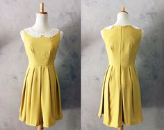 ETIQUETTE in Mustard - Vintage Inspired Dress in Mustard Yellow with Full Pleated Skirt, Hidden Side Pockets & White Lace Collars. $65.00, via Etsy.