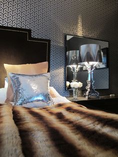 Kartell Bourgie lamp in silver and sequin cushions in bedroom