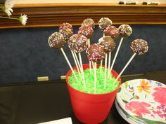 Cake pops that i made to go w/ the bridal shower cake.  Chocolate cake w/ almond bark coating and sprinkles, we put them in a flower pot coveredthe top w/ green coconut