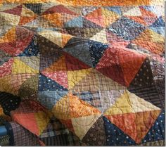 Effective use of half square triangles and color make a beautiful quilt that is easy to look at.