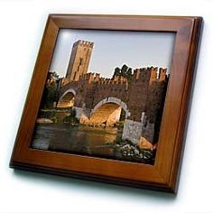 """Adige River, Bridge, Ponte Scaligero, Venetia, Italy - EU16 DBN0131 - David Barnes - 8x8 Framed Tile by 3dRose. $22.99. Dimensions: 8"""" H x 8"""" W x 1/2"""" D. Solid wood frame. Inset high gloss 6"""" x 6"""" ceramic tile.. Keyhole in the back of frame allows for easy hanging.. Cherry Finish. Adige River, Bridge, Ponte Scaligero, Venetia, Italy - EU16 DBN0131 - David Barnes Framed Tile is 8"""" x 8"""" with a 6"""" x 6"""" high gloss inset ceramic tile, surrounded by a solid wood frame with pre-drill..."""