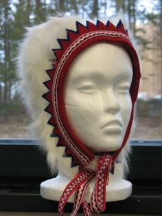 Always amazed how much the Finnish language contain Saami words! Cap or beanie in Finnish is 'lakki' | Kilakki, woman's headgear made of goat calf fur.