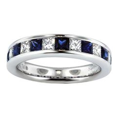 Mix and match! Beautiful diamond sapphire ring in white gold. Channel set princess cut sapphires and diamonds. Great anniversary ring or a stacklable ring.  Diamond Weight: (6) Princess Cuts 0.75cts;  Sapphire Weight: (7) Princess Cuts 1.15cts; Width:3.5mm