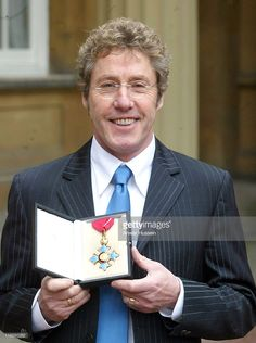 Roger Daltrey from the The Who in the courtyard of Buckingham Palace. The singer had just been honoured as a Commander of the British Empire (CBE) for services to music.
