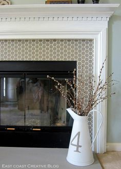 Stenciled Faux-Tile Fireplace Makeover!  Also like the fireplace doors