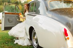 Bride in classic car provided by Regal Carriage in Knoxville, TN.