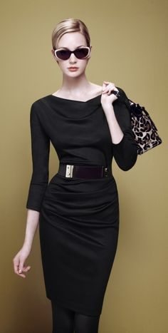 Black draped boat neck sheath with side ruching and wide black belt, large sunglasses, animal print handbag.