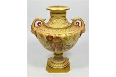 A Royal Worcester blush vase, decorated with scattered flowers, date code 1896. Height 23cm.