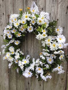 Do you like Daisies??? If you do, you will LOVE this wreath! There are daisies all around this wreath!!!  It can also be made on an 18 base. Lots of lush greenery with small yellow daises fill in between the white  daises. There is a white ribbon hanger on the top. If you would  like another color ribbon just contact me. This wreath is a great way to welcome spring and great to continue on through the summer or for any room year round.  Thank you for stopping by. Have a great day!.