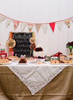 Love this bake sale themed dessert buffet table! Photo: Meg Smith