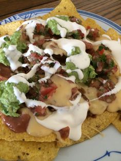 Yowser!  This was from a make your own nachos night!  We don't often suffer too much, food-wise, here in the Fink-Davis household!  I made refried beans with El Pato sauce (I love that stuff), some homemade nacho cheese sauce, fresh salsa, fresh guacamole, ground beef with taco seasoning, and some good sour cream and let everyone create their own plate of delicious nachos.  I prefer Tostitos natural, organic tortilla chips.