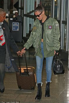 Headed home: The younger sister of model Gigia Hadid left the airport alone...