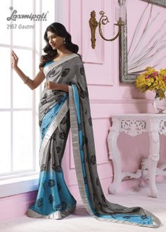 This Grey & sky blue  color satin chiffon material saree with silver color border & with black flower prints.