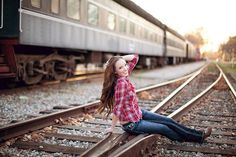 Don't play on train tracks, sit.