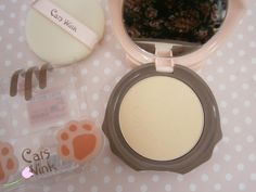 Tony Moly Cat Wink Compact  This is the darker shade out of two available.   The packaging's a teeny bit cheap feeling, but the quality of the actual powder is great! Looks amazing over bb cream - well worth it.