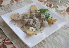 German meatballs, simmered in broth  and flavored with lemon and capers, Konigsberg style.