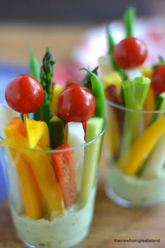 8 oz clear plastic party tumblers, assorted colorful veggies: asparagus green beans rainbow carrots jicama bell peppers English (or Persian) cucumber skinny green onions sugar snap peas  cherry tomatoes to put on the end of long toothpicks  whatever else you like dressing at the bottom