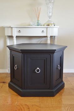 Classic mid modern hexagon side table. Retro cabinet in black. Round end table.