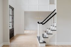 Black Staircase Steps Black Staircase Railing Paint color Benjamin Moore Black Besides open shelving what's becoming our signature is black staircases Almost every project we work on now requests them It's edgy yet classic and we feel are timeless Together with White Oak flooring it provides the right amount of contrast Black Staircase Steps Black Staircase Railing Paint color Benjamin Moore Black #BlackStaircase #BlackStaircaseSteps #BlackStaircaseRailing #Blackrailing #Paintcolor… Painted Kitchen Cabinets Colors, Beautiful Bathroom Vanity, Cabin Interiors, Finding A House, Dining Room Paint, Full House Renovations, Beautiful Bathrooms, Cabin Interior Design, Large Farmhouse Dining Table