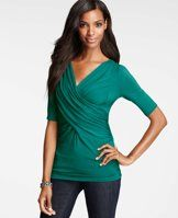 Cross Drape Top - Endlessly slimming, this alluring criss-cross silhouette fits and flatters to perfection in a range of spectacular colors. V-neck with crossover front. Short sleeves.