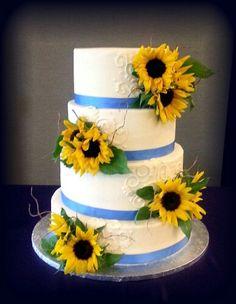 Sunflower wedding cake, with garnet satin around instead of the blue