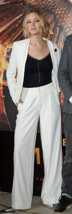 Elegant in white: Jennifer Lawrence pulled off a menswear inspired look at the The Hunger Games: Mockingjay Part 1 photocall