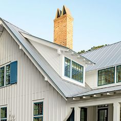 Exterior: The Roof | Extended overhangs show off simple rafters around the house. The M-shaped chimney flue keeps water out of the fireplace and was inspired by the work of architect A. Hays Town.
