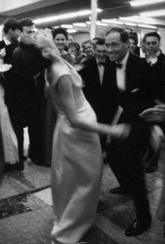 Audrey Hepburn and Mel Ferrer let loose on the dance floor at the annual children's hospital benefit charity ball on liner France, January 14, 1962.