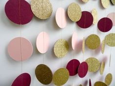 This garland has gold glitter on the front and alternating blush pink and burgundy card stock on the back. I cant even describe how gorgeous these colors are together with the gold glitter in person... photos do not do justice. I made several of these recently as a custom order and