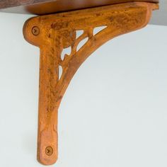 """Clover Cast Iron Shelf Bracket - 6-1/2"""" x 5-3/4"""" - Rust by Whittington Collection. $12.95. Add a charming touch to your home with this iron shelf bracket that features a small three-leaf clover motif and other decorative cutouts. Shown in Rust finish. Bracket dimensions: 6-1/2 L x 5-3/4 H. Shelf support section of the bracket is 1-1/2 wide. Wall support section of the bracket is 7/8 wide; 2-3/8 wide where the mounting screws are placed. Made of durable cast iron. Rust finish i..."""