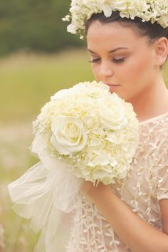 A Gorgeous Ballerina Bouquet With White Hydrangea, White Roses, & Baby's Breath Hand Tied Together With White Tulle....Model Wears A Coordinating Fresh Floral Halo****