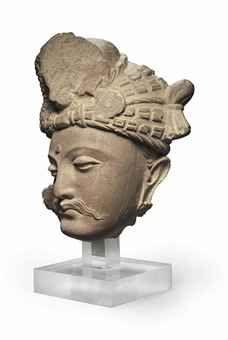 """A SCHIST HEAD OF A BODHISATTVA GANDHARA, 2ND/3RD CENTURY 8"""" 15,000"""