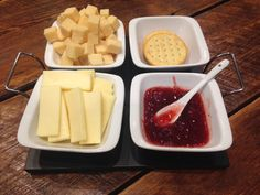 The cubed cheese is our newest addition: cheddar aged in the caves of Vermont! In front, we have a creamy Havarti, and then a strawberry basil preserve with Monet crackers in the back!