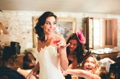 Neat idea: This bride didn't have bridesmaids, but invited her 10 closest girlfriends to get ready with her in the bridal suite and hang out on wedding morning. Love it. Photography By / weareyourphotogs.com