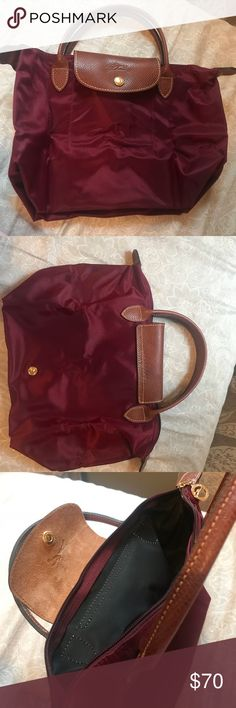 Long Champ LePliage S top handle bag This beautiful burgundy color long champ le pliage tote in small size with black interior andtop handle looks elegant with any outfit. Used extremely rarely (3-4 times) is in impeccable condition and looks like brand new. Has one spot on the back side that may be wiped off with a cleaner or water. Leather looks great! Longchamp Bags Totes