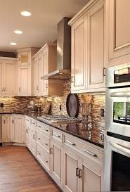 tan cupboards with dark floor - Google Search