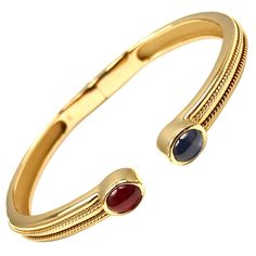 TIFFANY & CO Ruby Sapphire Yellow Gold Bangle Bracelet | From a unique collection of vintage bangles at http://www.1stdibs.com/jewelry/bracelets/bangles/
