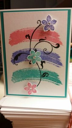 Use stamp pad for sweep of color, then stamp and cut out..  Stampin Up work of art stamp set