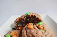 Bakery Style Halloween Cookies are thick, chewy and extra-large chocolate cookies filled with chocolate chips and Halloween candy. Halloween is upon us once again! Spooky season and a reason to make horror themed goodies and watch scary movies all day everyday! Today we celebrate Halloween with these Halloween themed bakery style cookies. Thick and chewy bakery style chocolate cookies filled with Halloween themes M&Ms. Now, I used a mixture of chocolate chips and Halloween themes M&Ms but you co