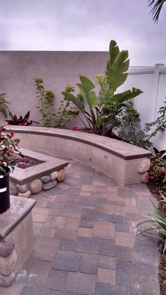 Fire Pit and Seat Wall finished with stucco, faux stone and concrete cap.