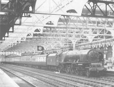 Ex-LMS 4-6-2 Princess Coronation class No 46237 'City of Bristol' is seen standing at Platform 7 on the 2 35pm Wolverhampton to Paddington service