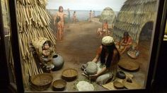 """Diorama showing a Chumash Indian mother and baby. The Chumash people are one of many Native American tribes that once dominated what is now the USA. Located in modern day Santa Barbara, California, between the coast and the Santa Ynez Mountain range, the Chumash called themselves """"the first people"""". Scholars have determined the Chumash resided in this region for at least 11,000-13,000 years, thriving due to their proximity to the sea and the fertility of the land."""