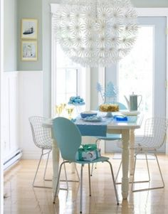 This giant white sphere, otherwise known as the Ikea Maskros light, adds drama and a little warmth to a Scandavian-spare dining room.