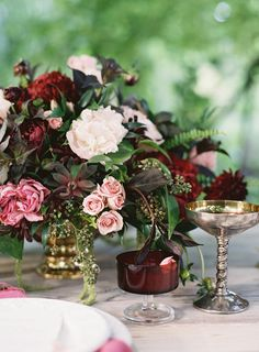 Other tables will have a gold compote vase filled with seasonal greenery, jasmine vine, gold seeded eucalyptus, burgundy roses, deep pink spray roses, and blush pink lisianthus surrounded by gold mercury glass votives.
