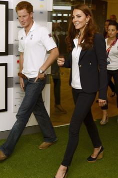 August 9, 2012 — During the London 2012 Olympic Games, Kate and her brother-in-law Harry visited athletes at the Team GB House in the Westfield Centre wearing similar outfits of jeans and white polo shirts. Kate accessorized her look with a pair of cork wedges.