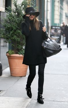 Miranda Kerr in black everything: The Row sweater, Frame Denim skinny jeans, Tabitha Simmons boots, and Rag & Bone hat with Givenchy bag.